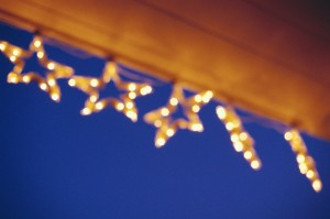 Star Christmas Lights Hanging from an Eave